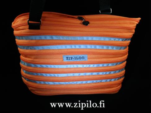 Heijastava Zip-Ilo olkalaukku on pimeän ajan pelastus.